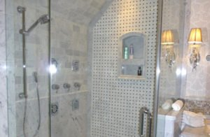 Marble tile shower with Body Sprays